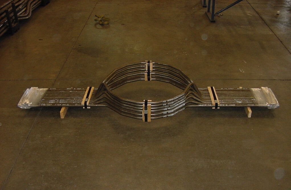 Roll Bending Large Radius Conical Boiler Rear Wall Opening Tubes.